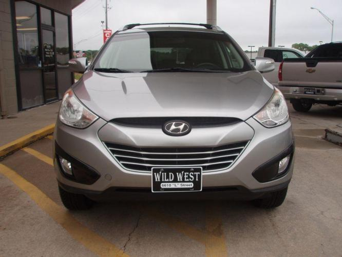 2012 GRAY HYUNDAI TUCSON GLS (KM8JUCAC8CU) with an 2.4L engine, Automatic transmission, located at 6610 L St., Omaha, NE, 68117, (402) 731-7800, 41.212872, -96.014702 - Photo #1